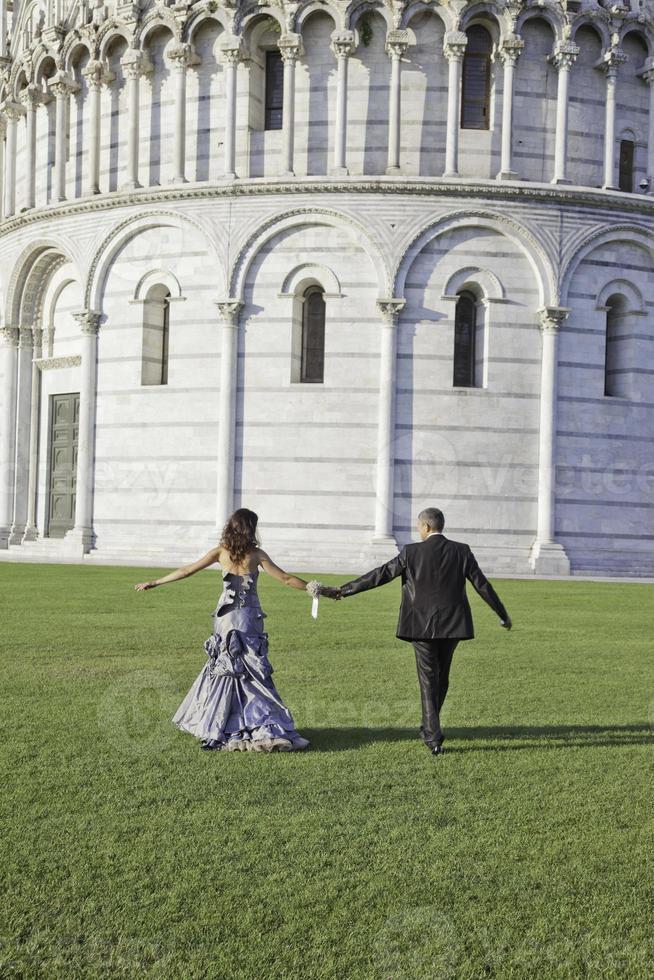 Bride and Groom walking after Wedding Ceremony in Pisa photo