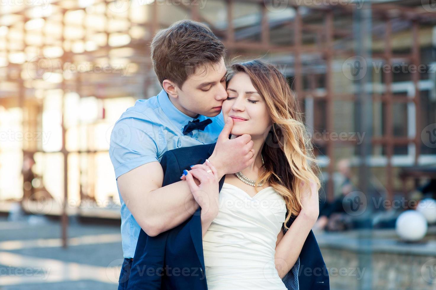 happy bride and groom walking in the city at spring photo