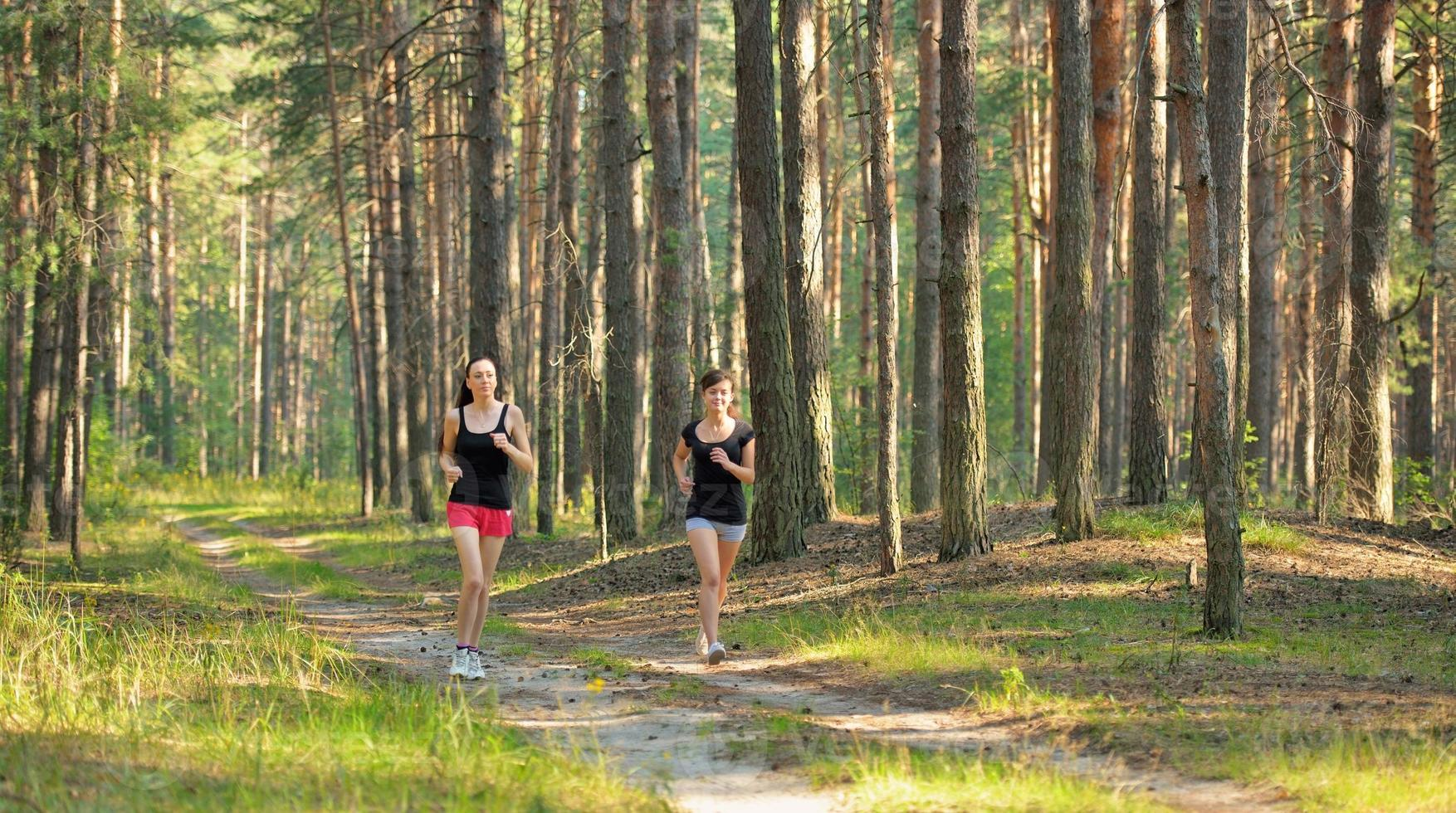 Two woman Jogging in forest photo