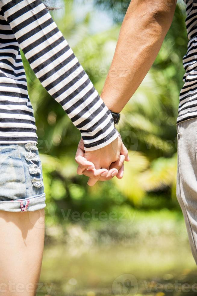 Lovely couple hold the hands photo