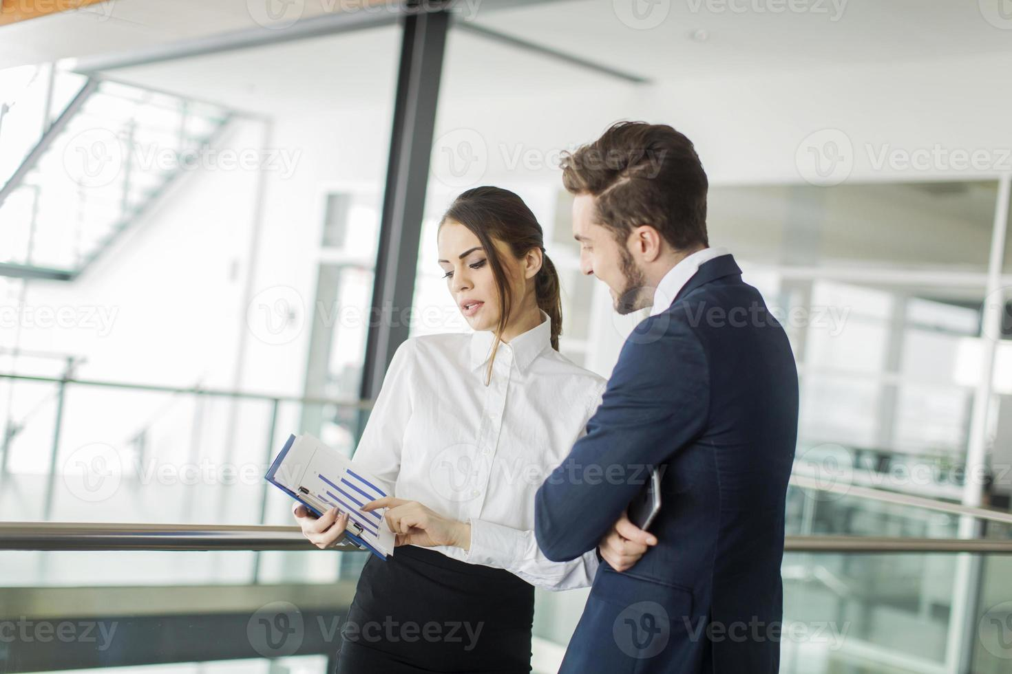 Young couple in the office photo