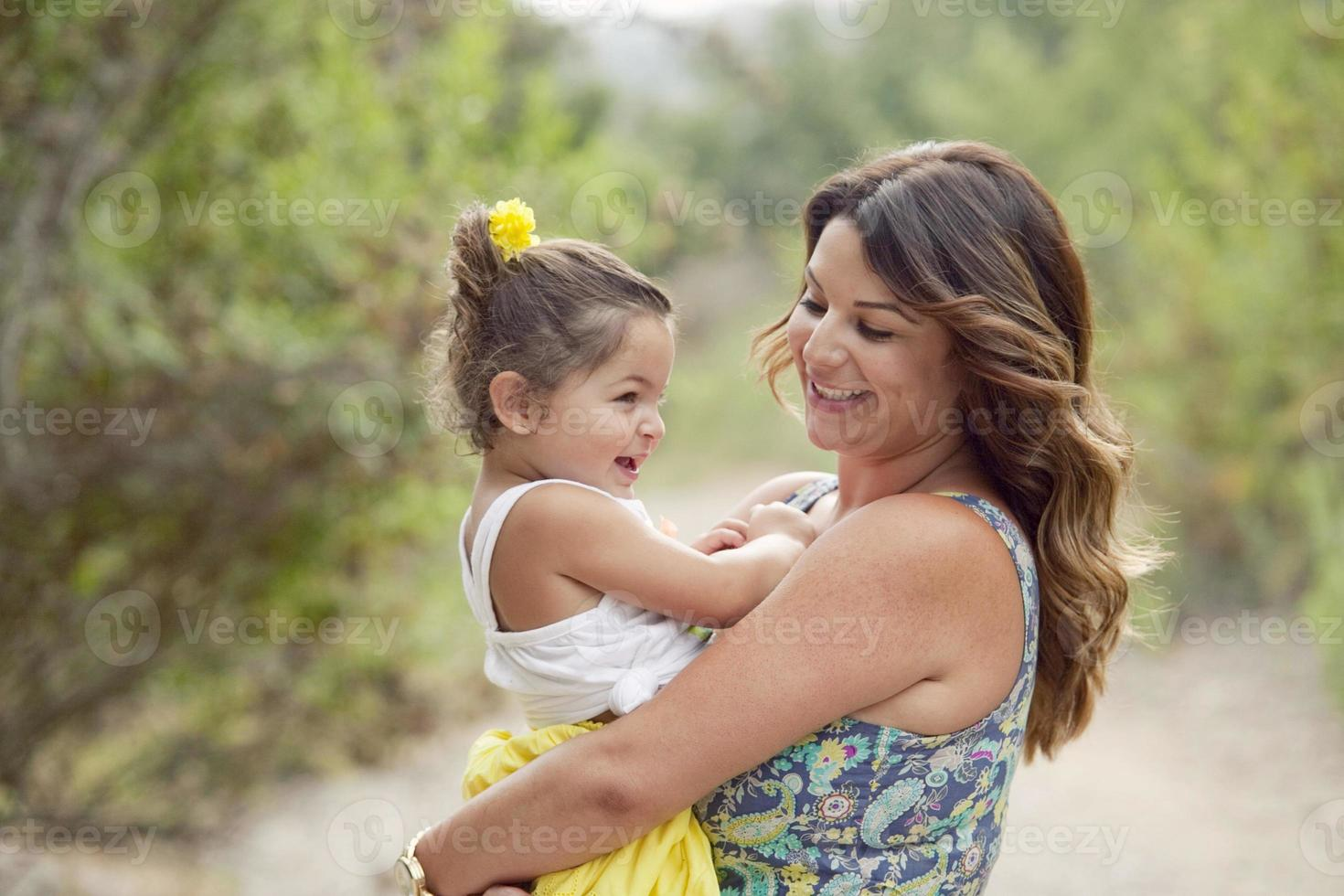 Brunette mother and daughter laughing photo