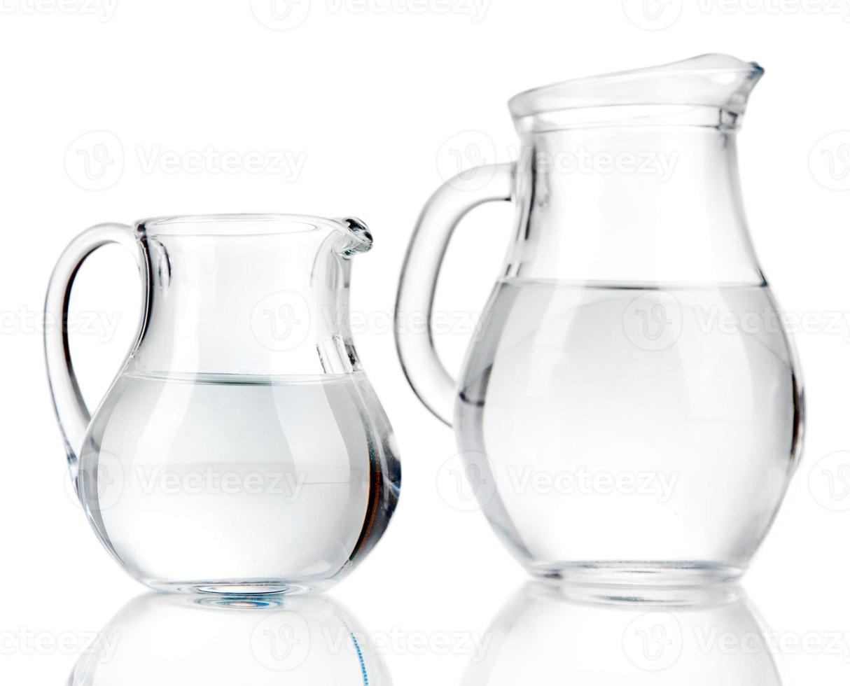 Glass pitchers of water isolated on white photo