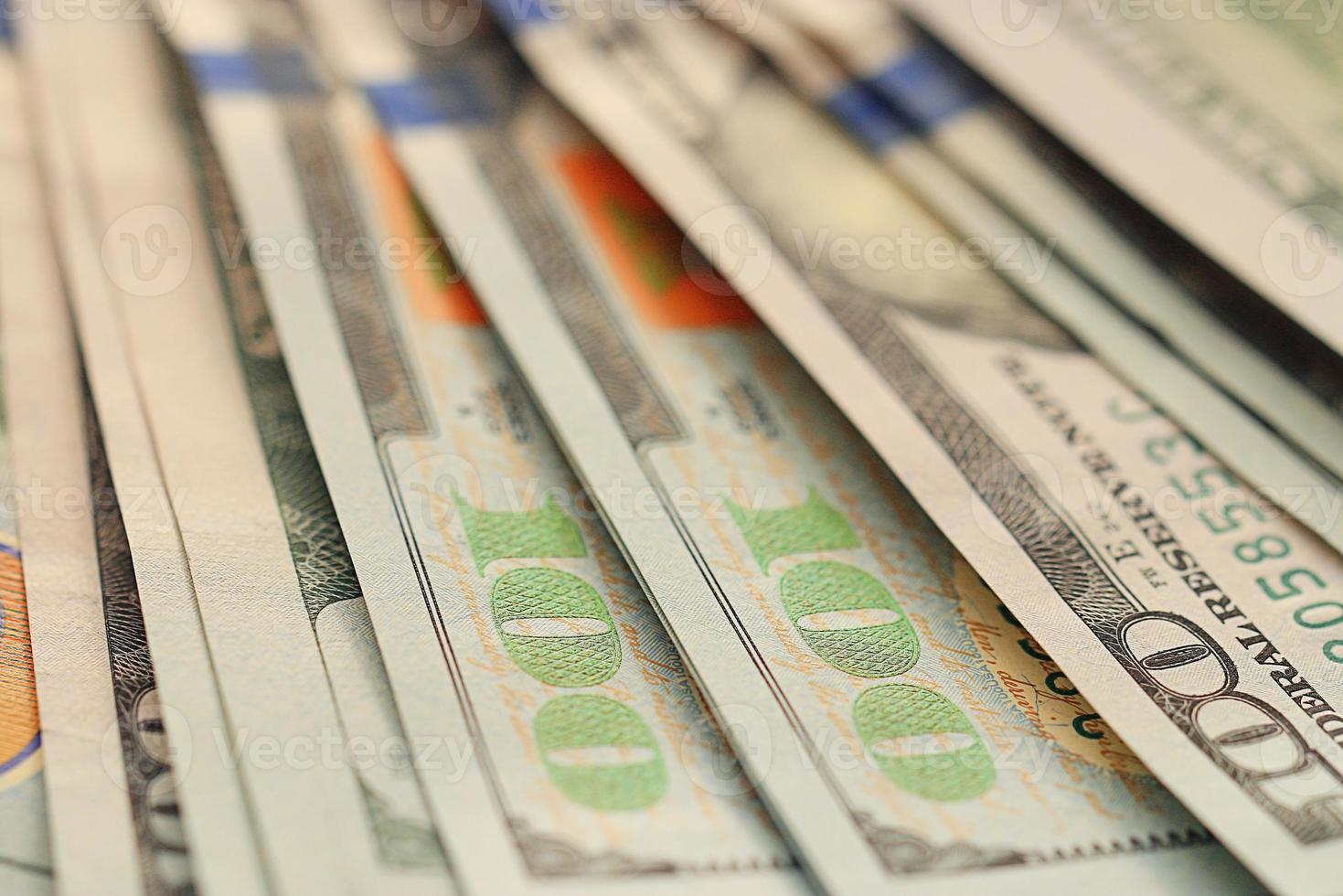 Fragmento de billetes de dólares estadounidenses de fondo foto