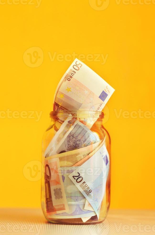 saving euro money in glass jar photo