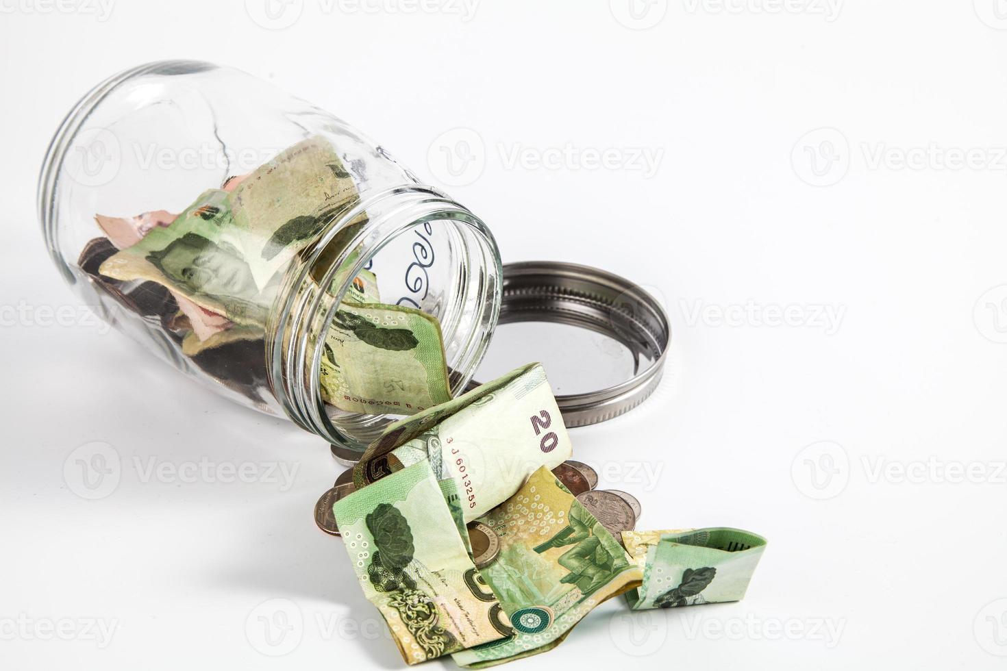 Money jar with isolate white background photo