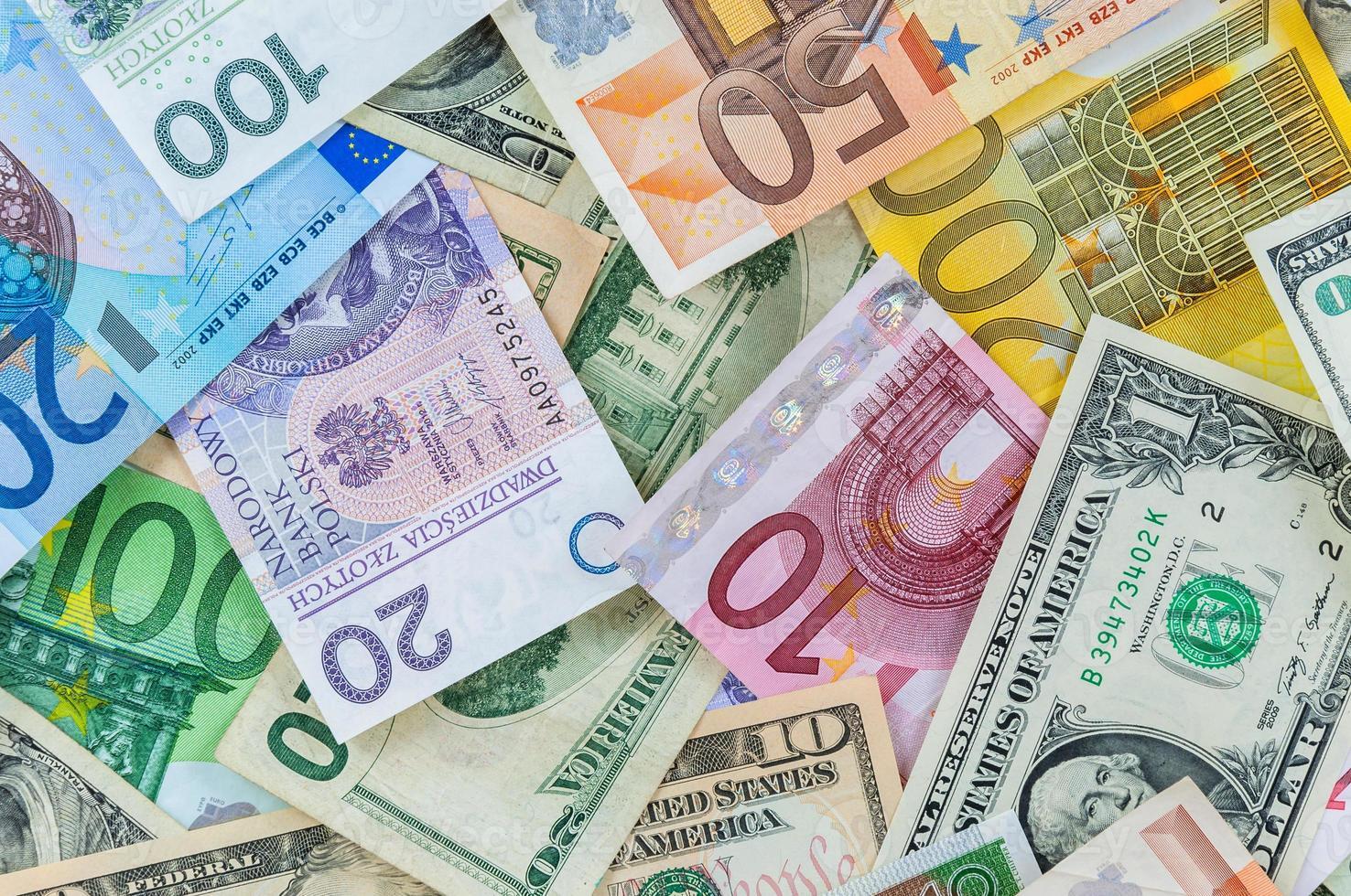 Dólar, euro y fondo de dinero polaco zloty foto