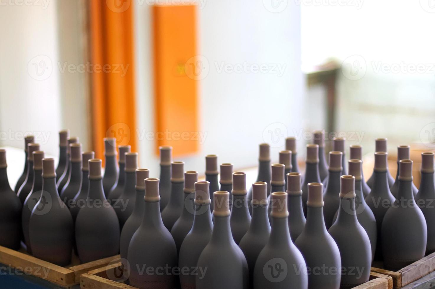 stacked up wine bottles in the cellar, dusty but tasty. photo