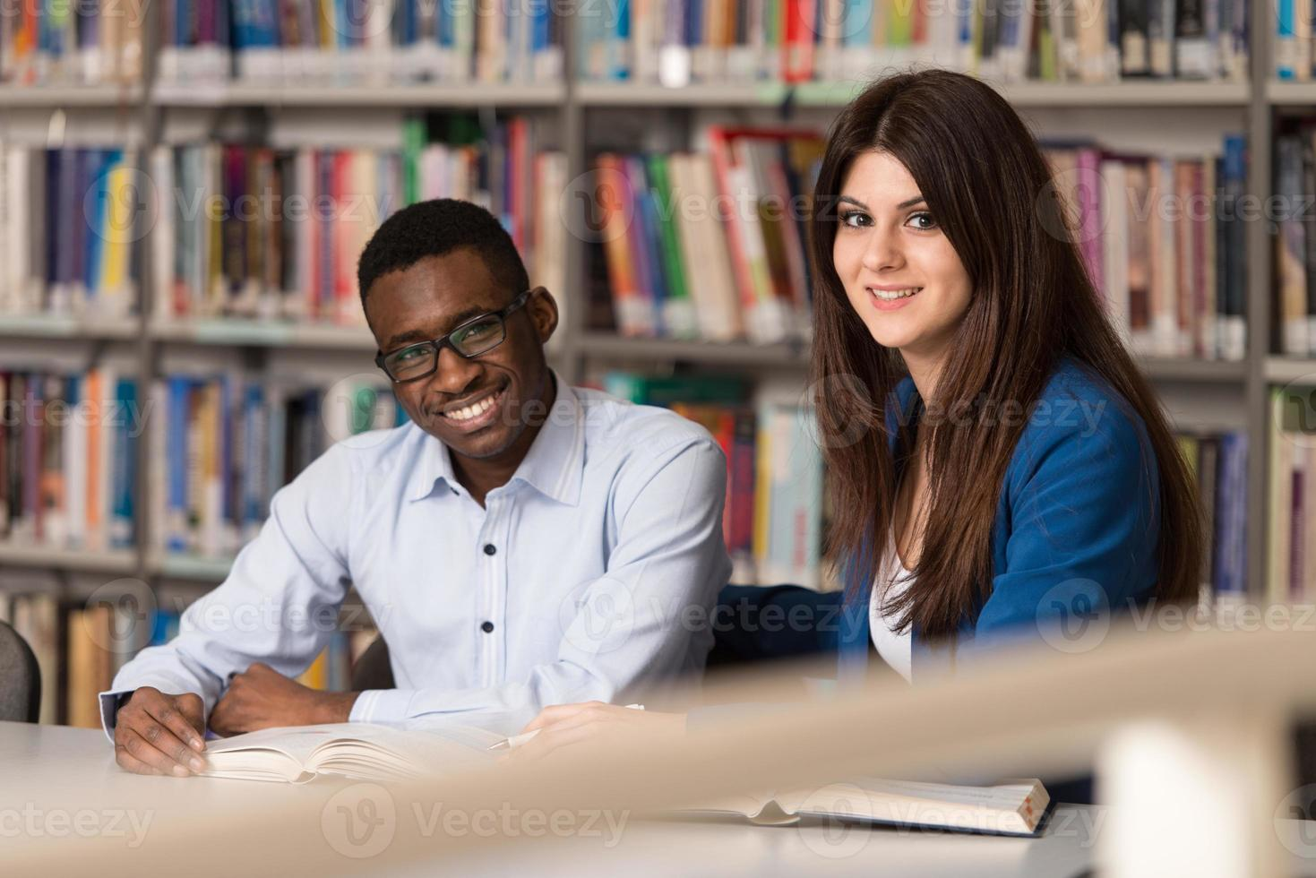 People Studying In A Library photo