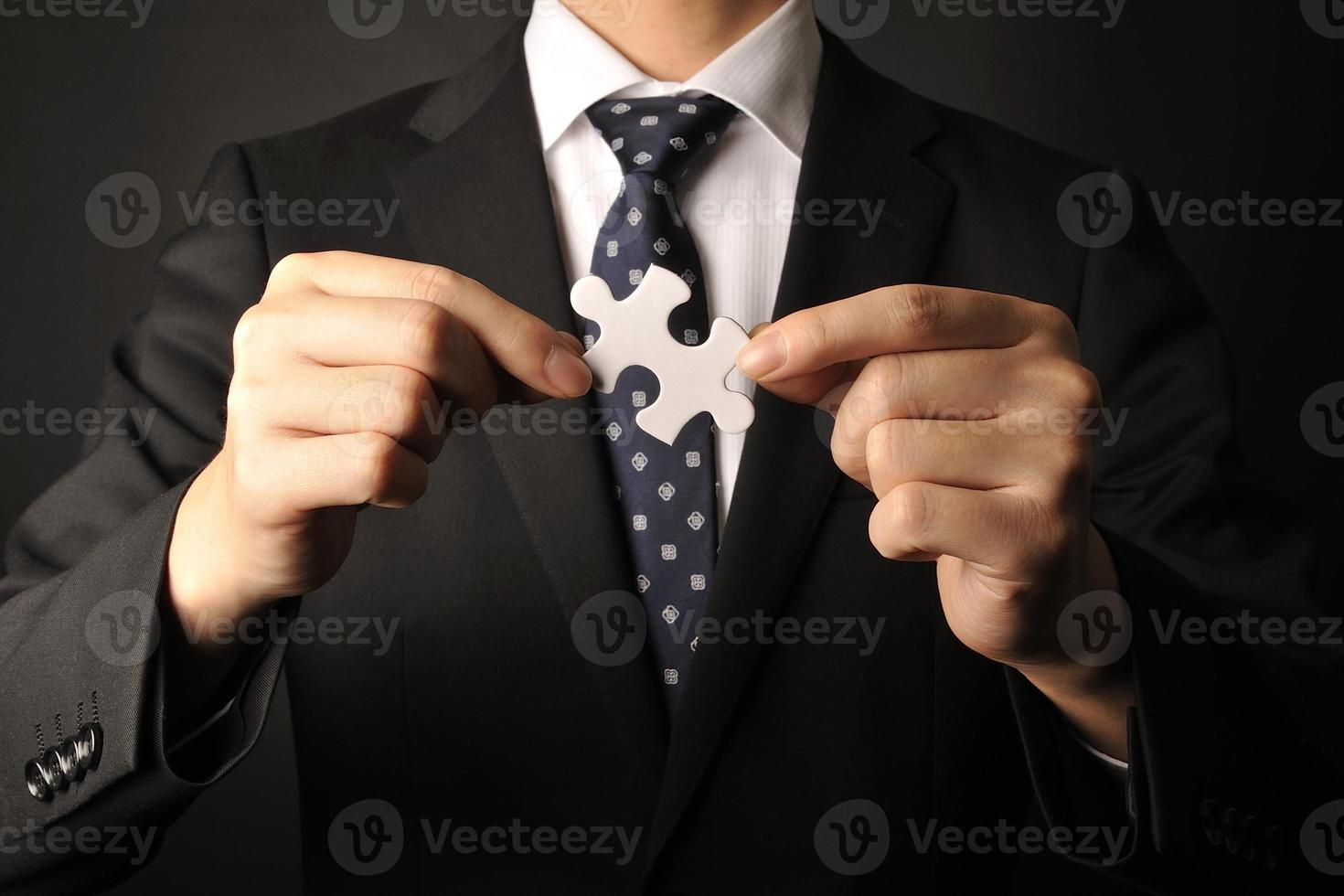 People who have a jigsaw puzzle piece photo
