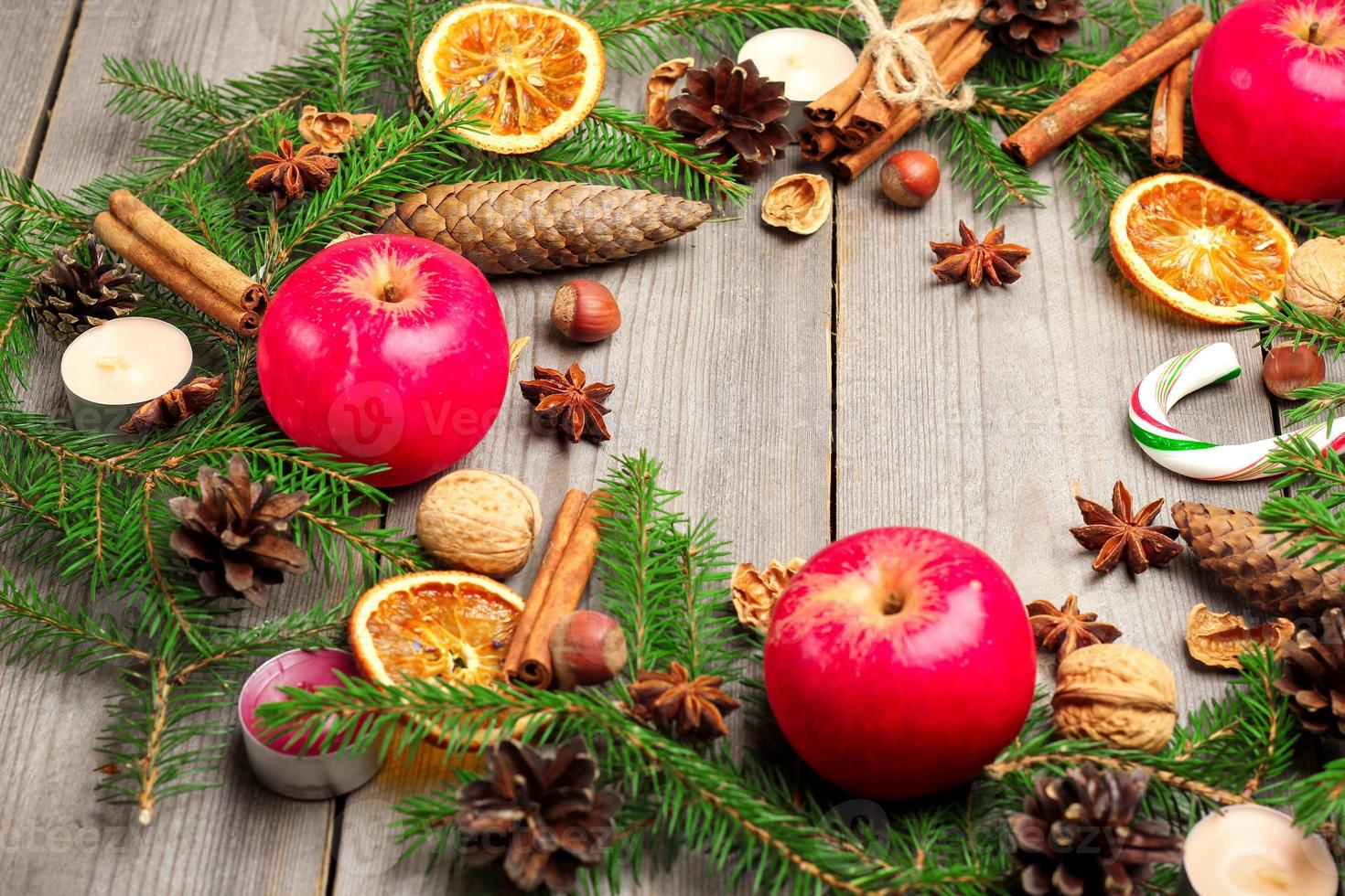 Christmas decoration with fir tree, oranges, cones, spices, appl photo