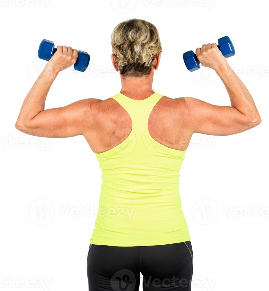 woman doing arms exercises with dumbbell photo