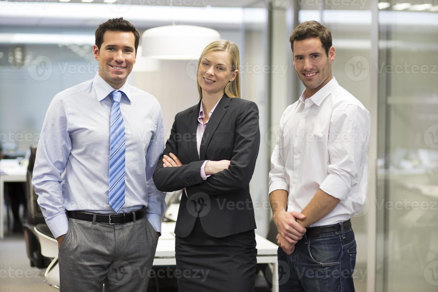 Portrait of joyful business team office background photo
