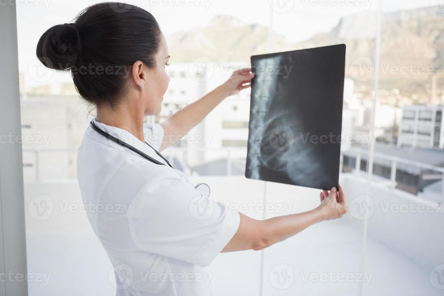 Doctor checking a patients x ray photo