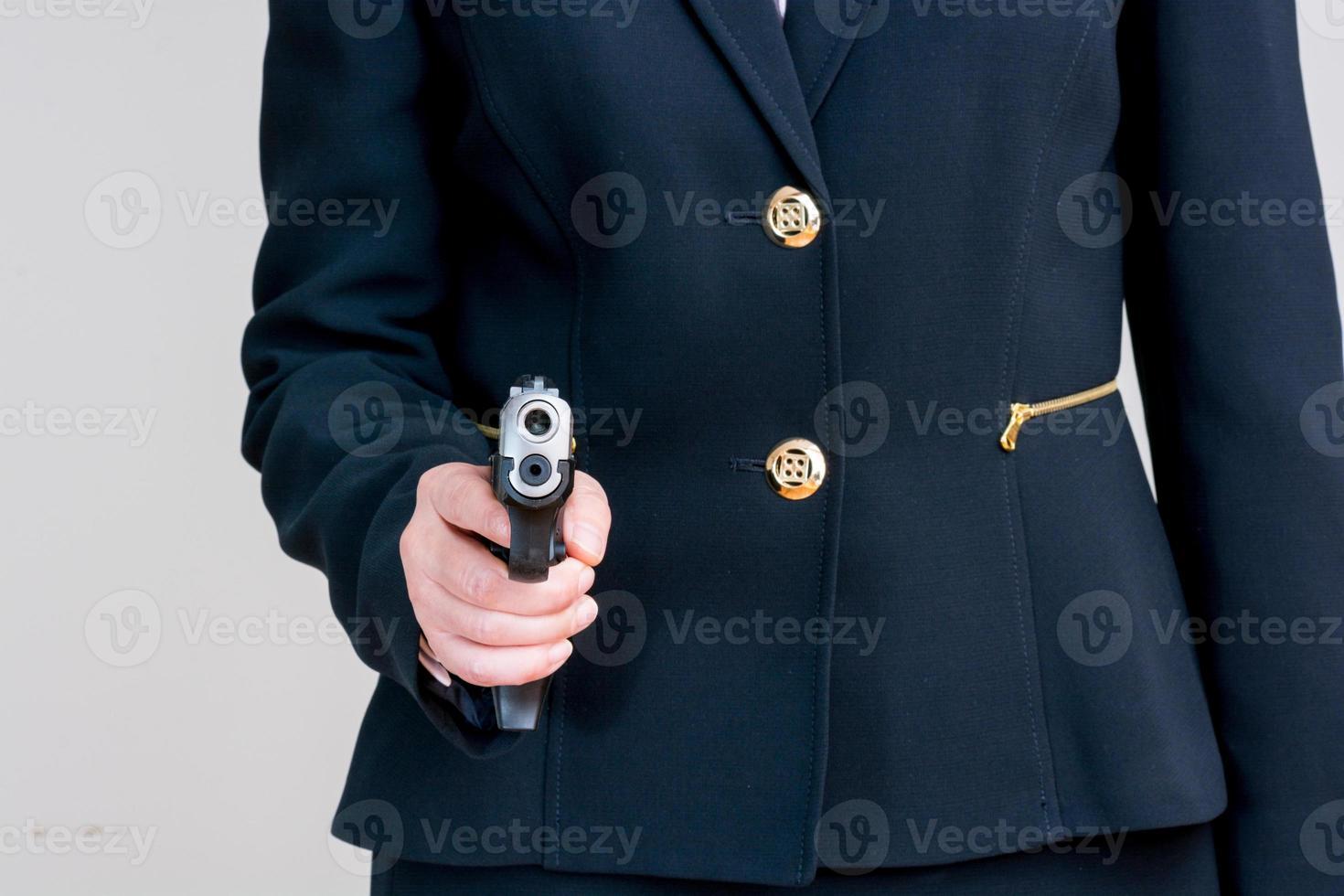 Woman pointing a hand gun photo