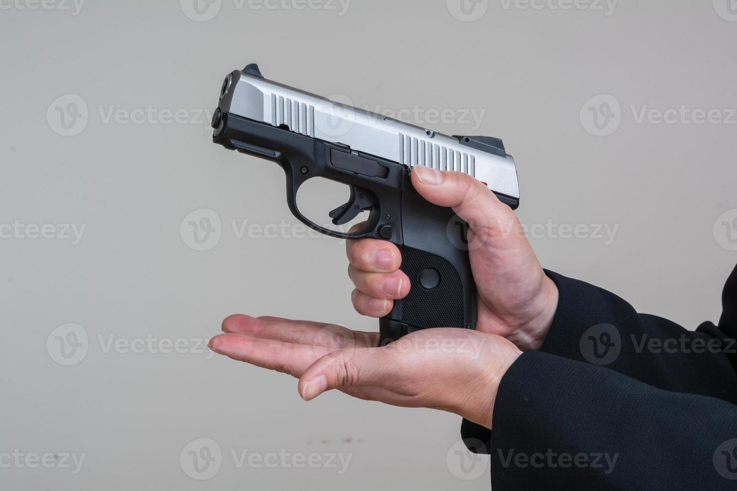 Woman loading a hand gun photo