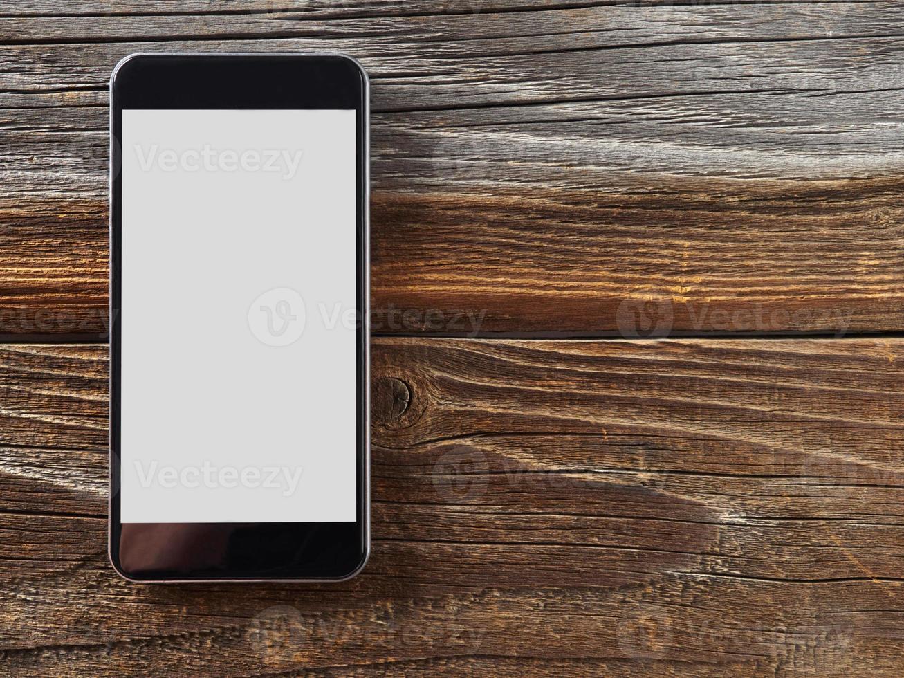 Smartphone on wood photo