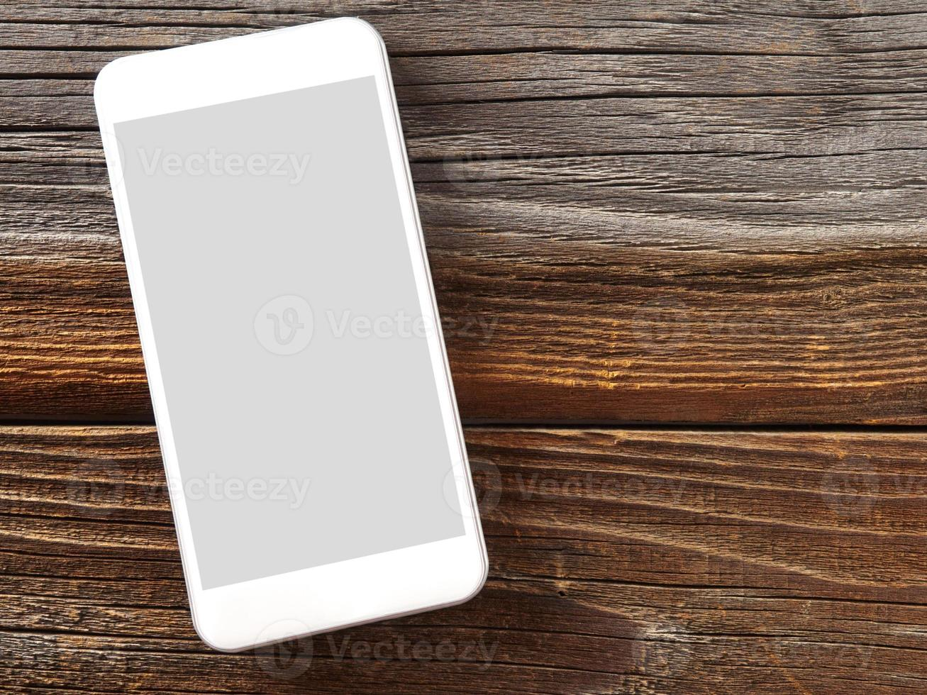 teléfono inteligente en madera foto