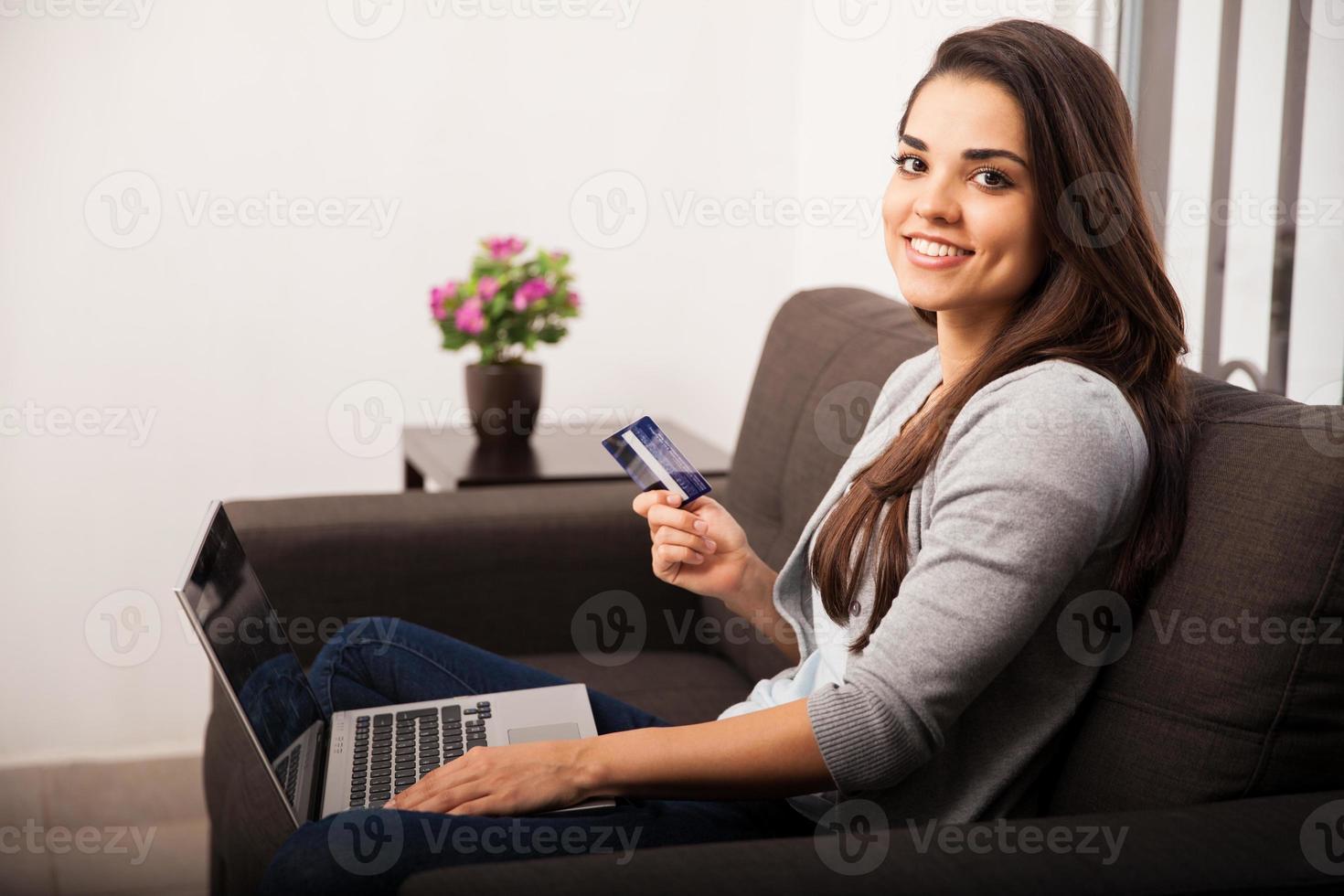 Cute girl shopping online photo