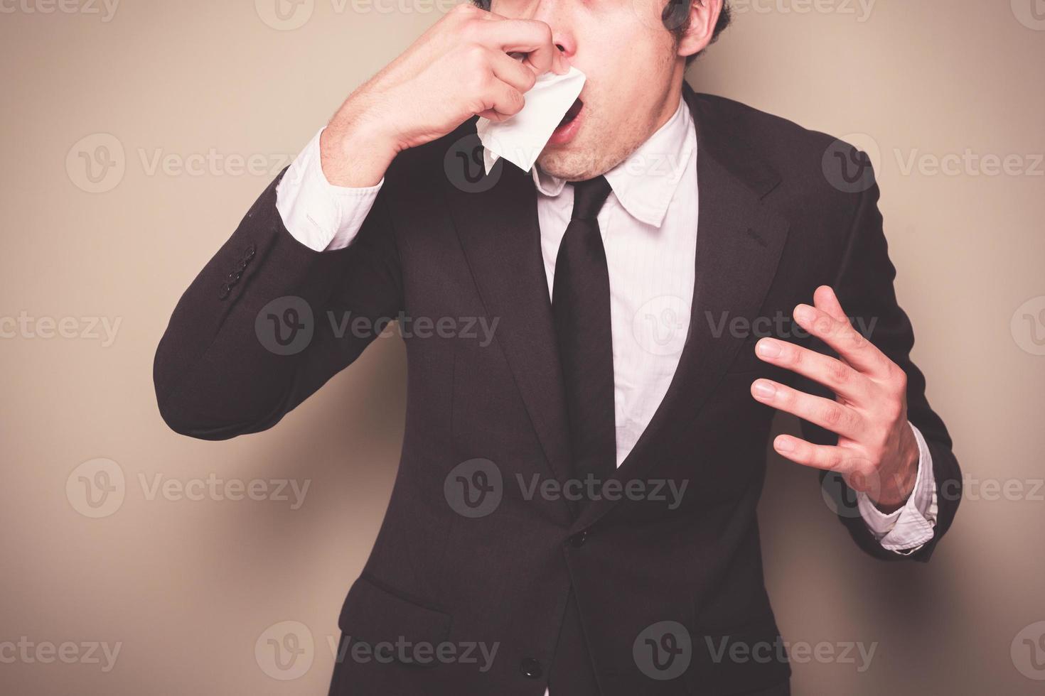 Businessman sneezing photo