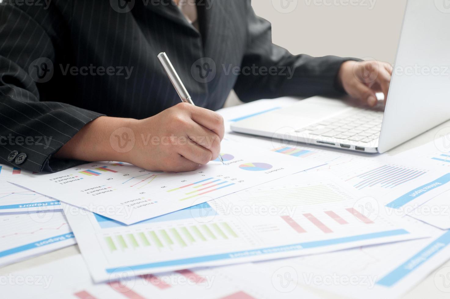 Businesswoman examine finance photo