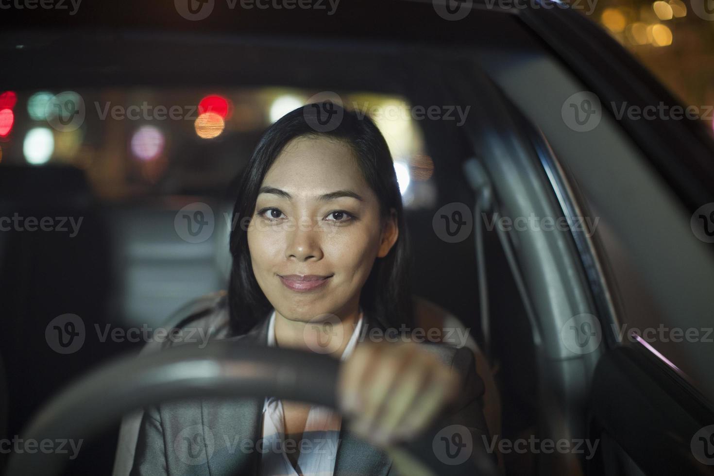 Businesswoman Driving Car photo