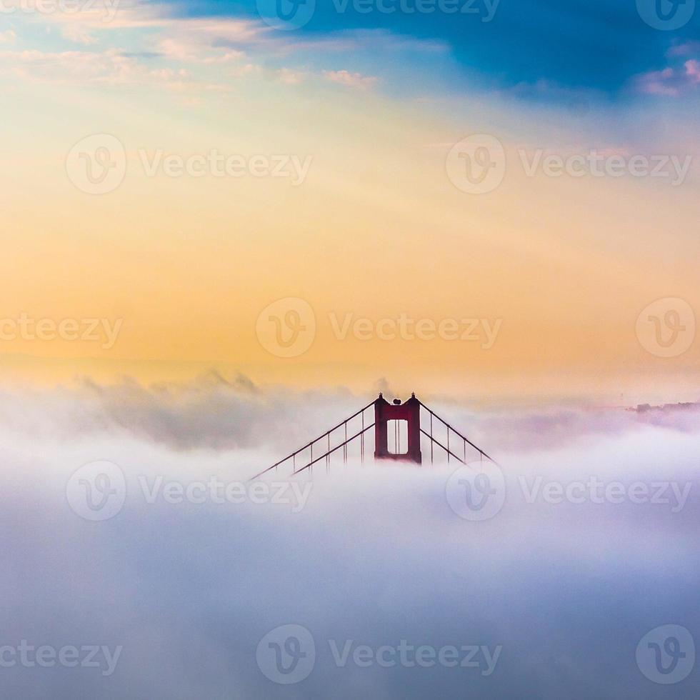 Golden Gate Bridge above Clouds after sunrise in San Francisco photo