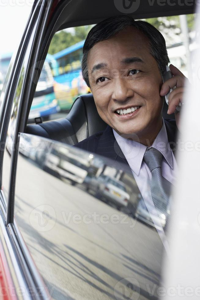 Businessman Using Cell Phone In Car photo