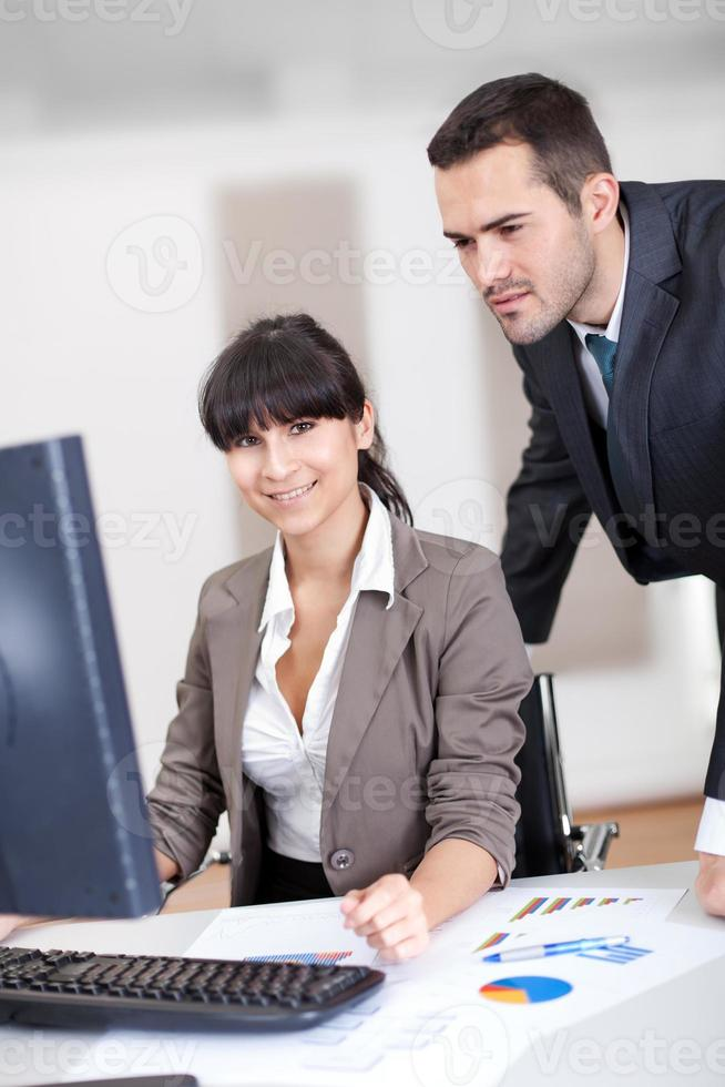Manager overseeing business woman photo