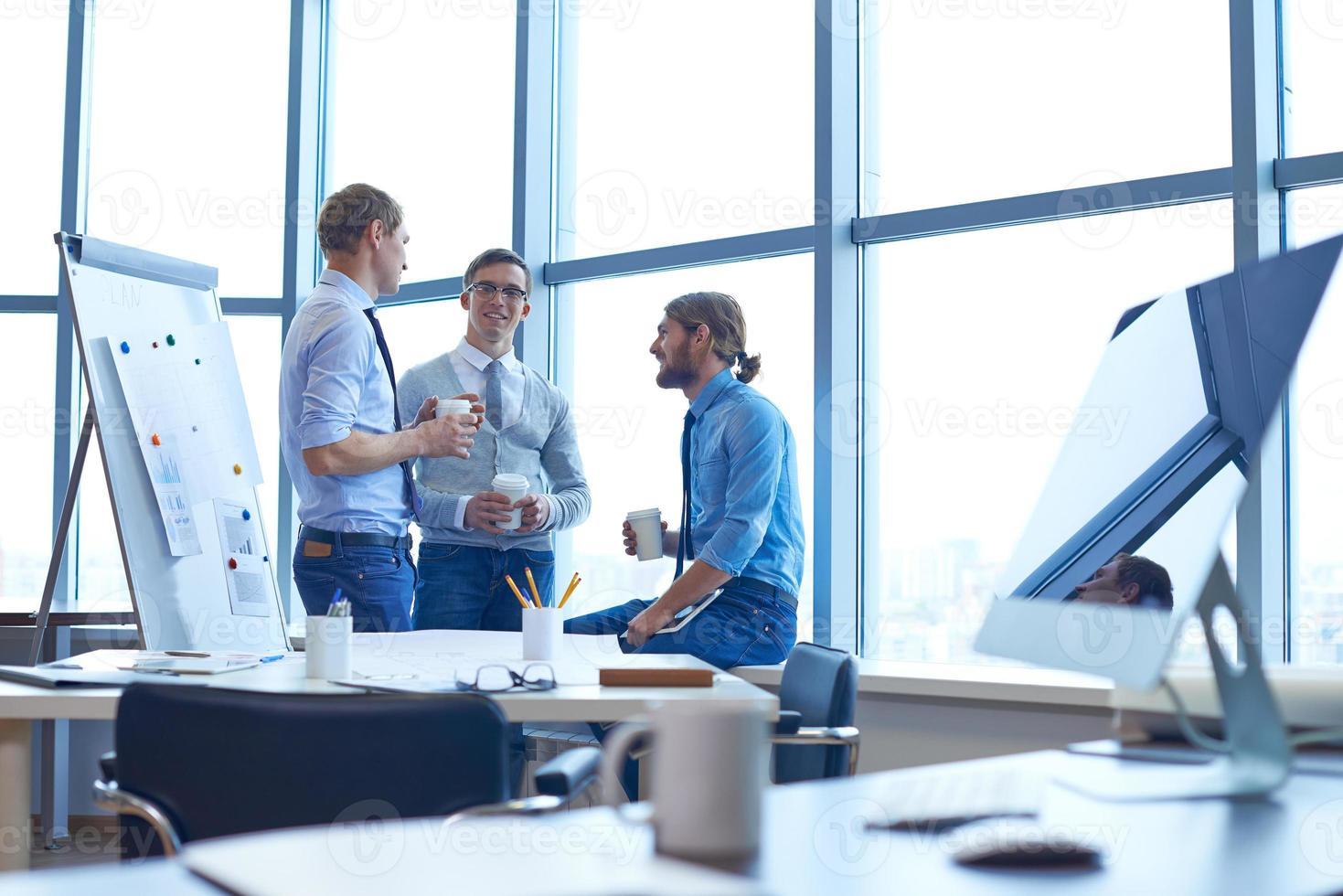 Businessmen consulting photo