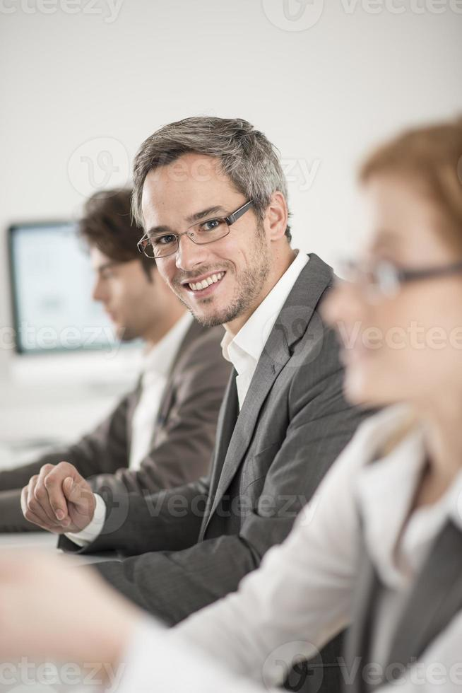 portrait of businessman during a meeting photo