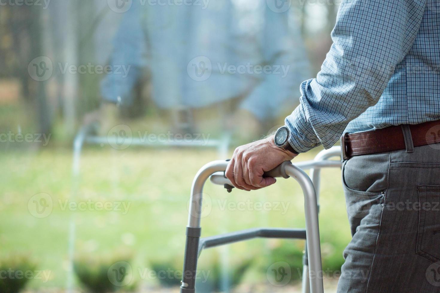 Leaning on walker photo