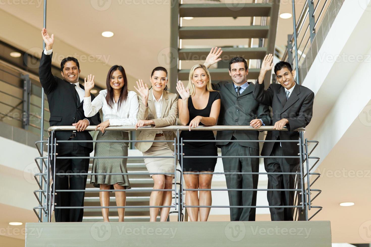 business people waving at stairway photo