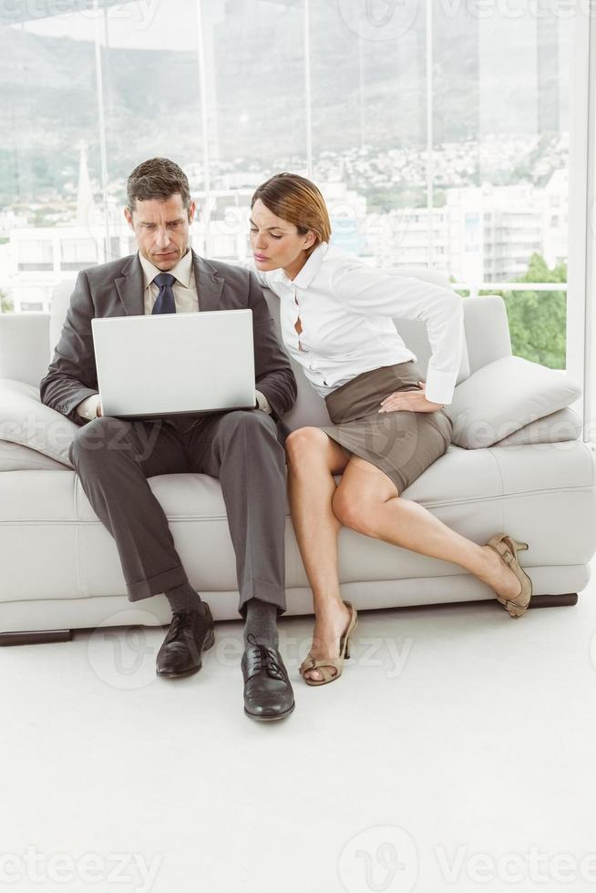 Business people using laptop photo