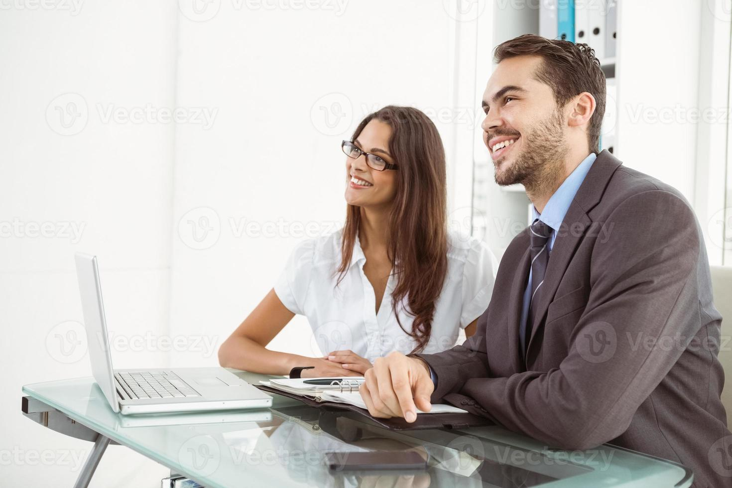 Business people using laptop in office photo