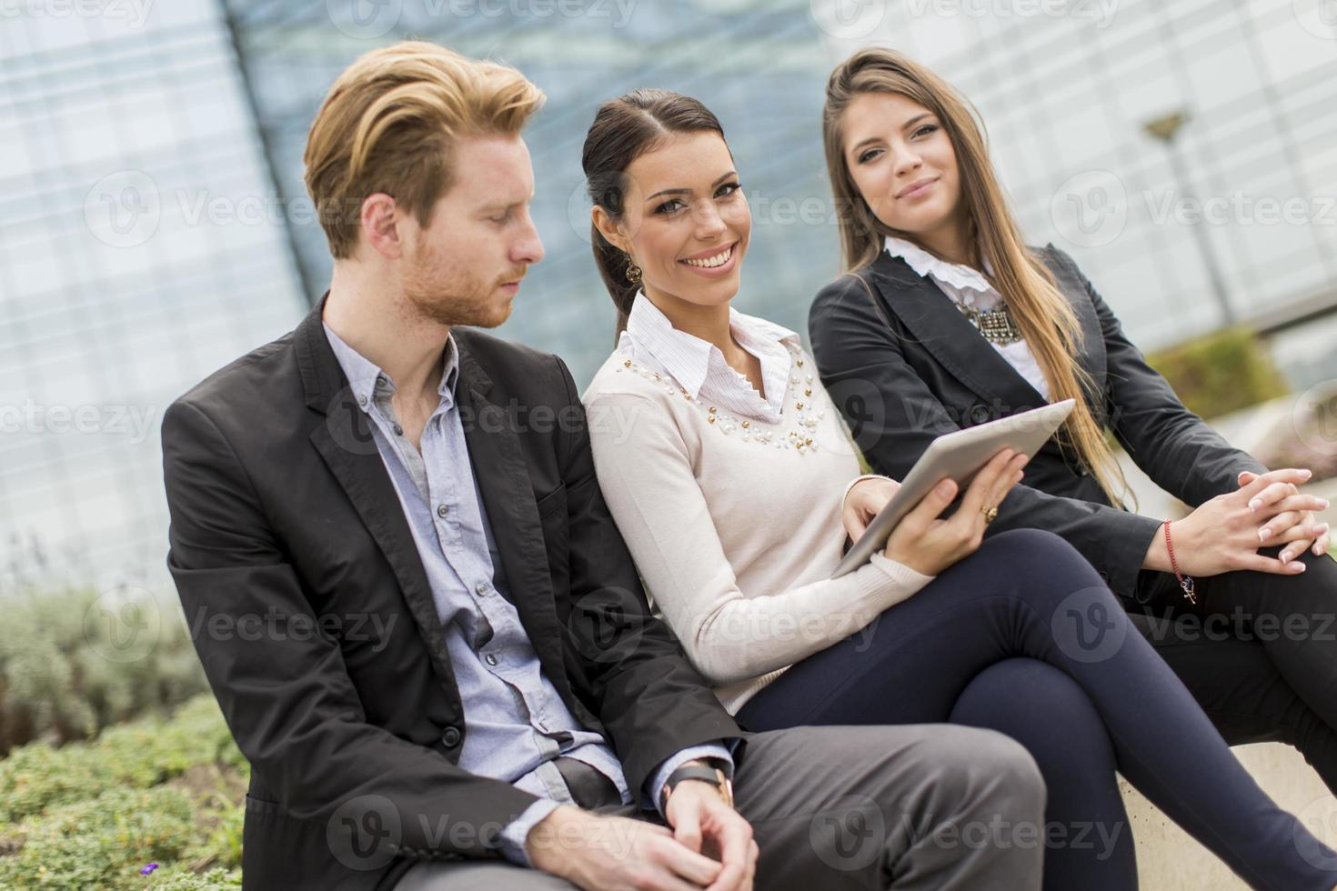 Young business people outdoors photo