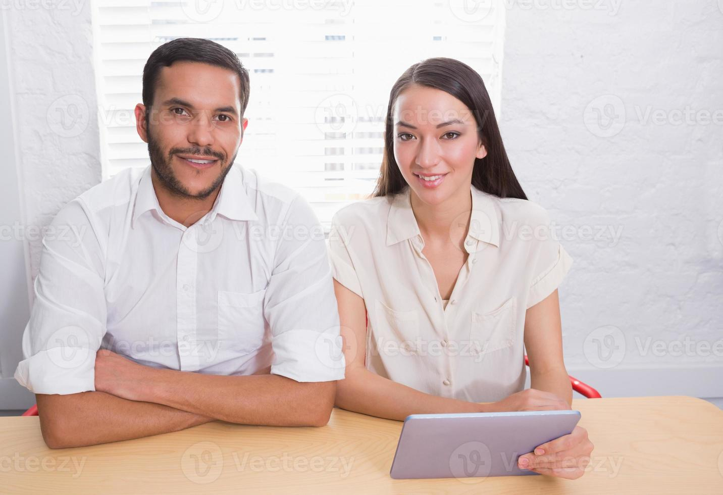 Casual business people using digital tablet photo