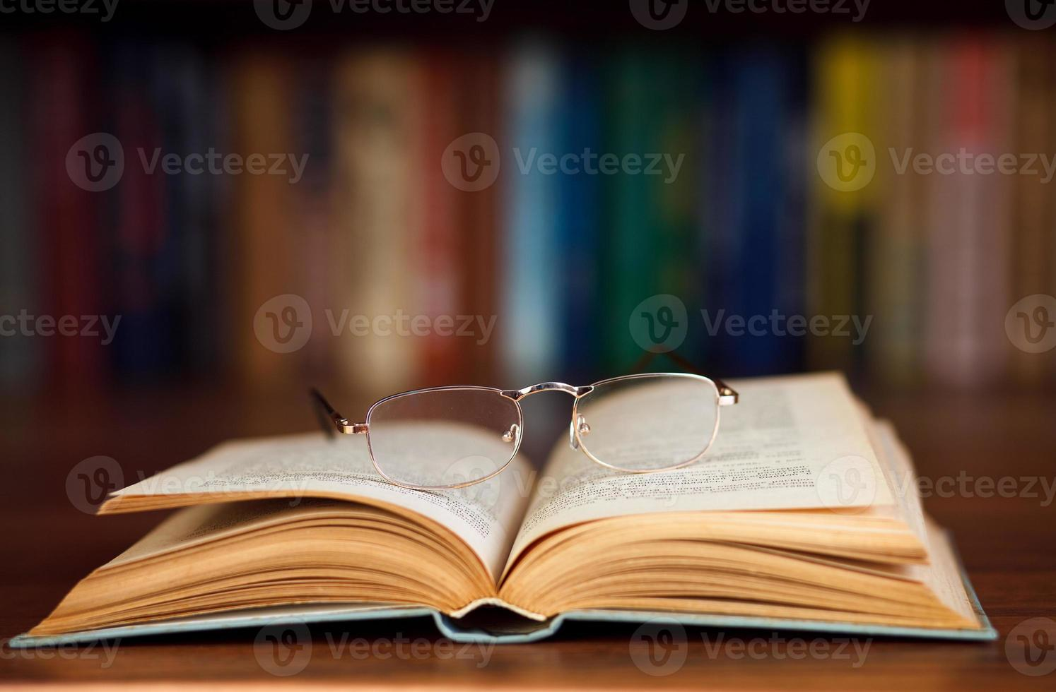 Glasses on a book photo