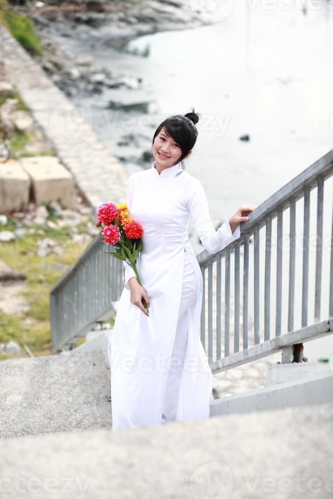 Vietnamese young girl in white traditional dress aodai photo
