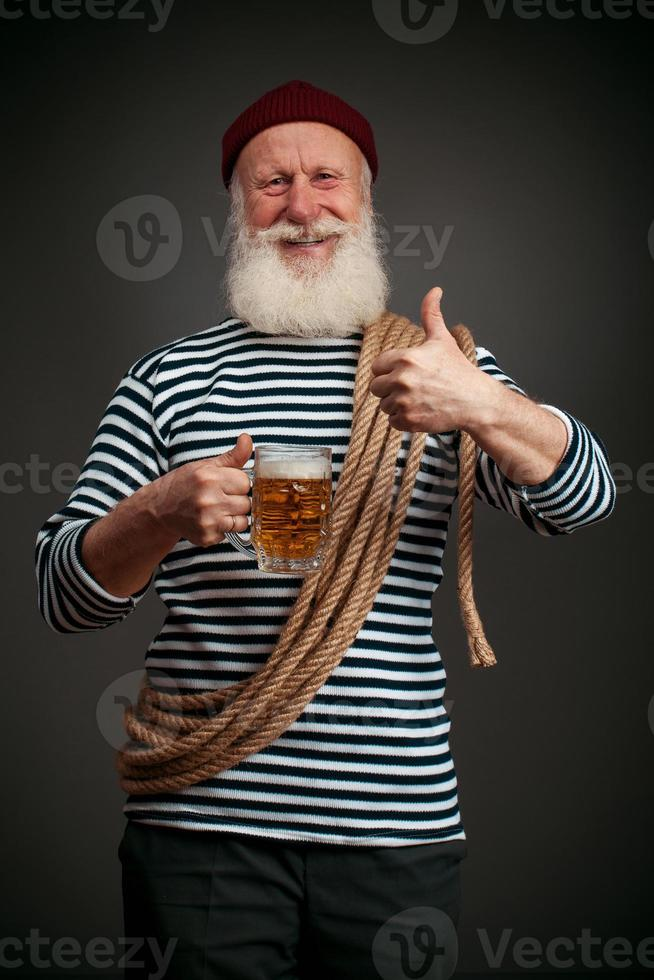 Handsome sailor isolated. Seaman with beer photo