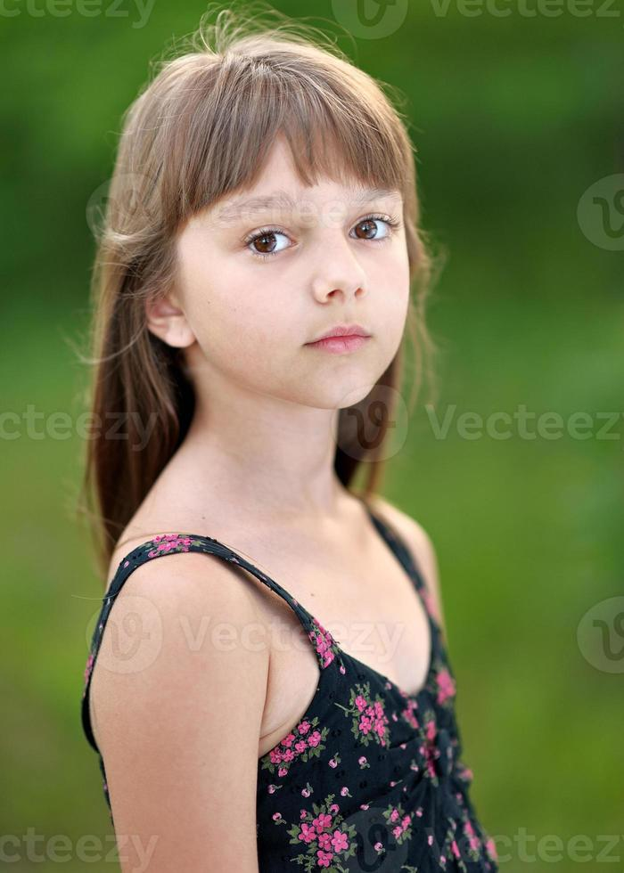 portrait of little girl outdoors in summer photo
