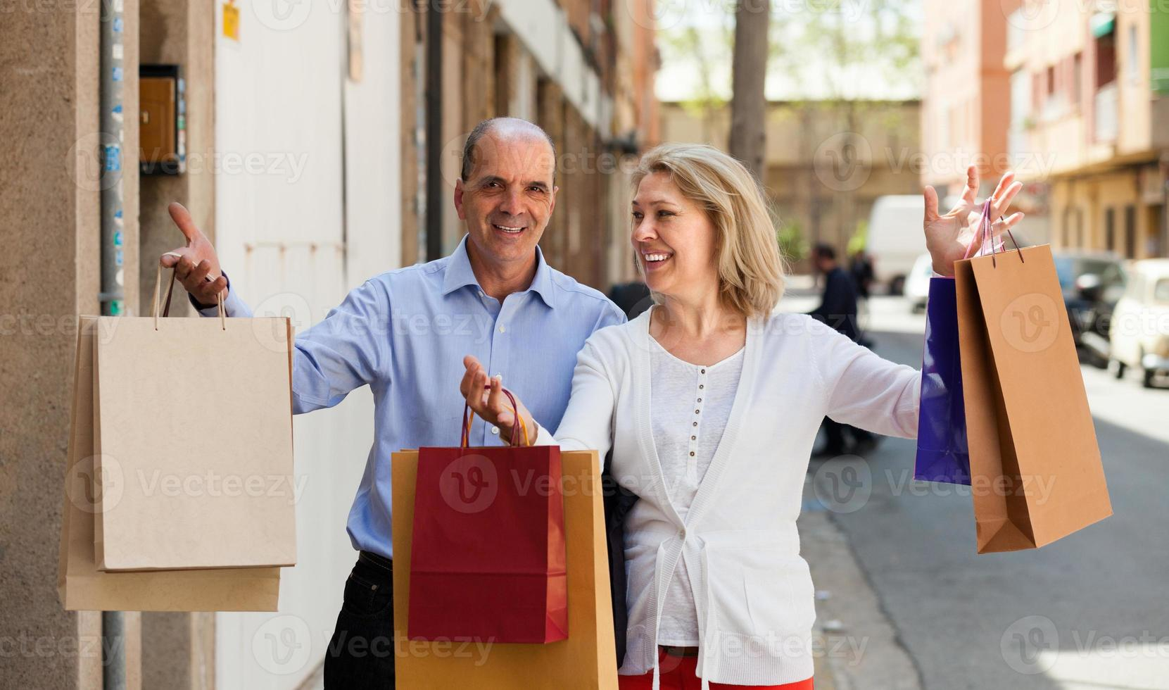 Aged couple with purchases photo