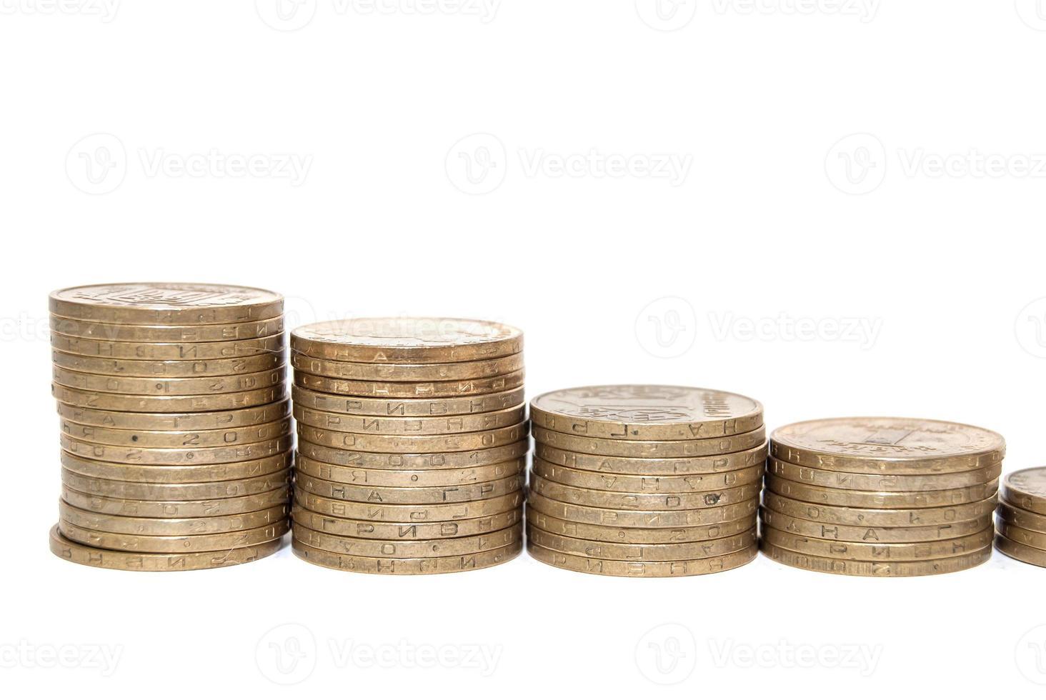 El gráfico con moneda moneda muestra el éxito y el crecimiento en los negocios foto