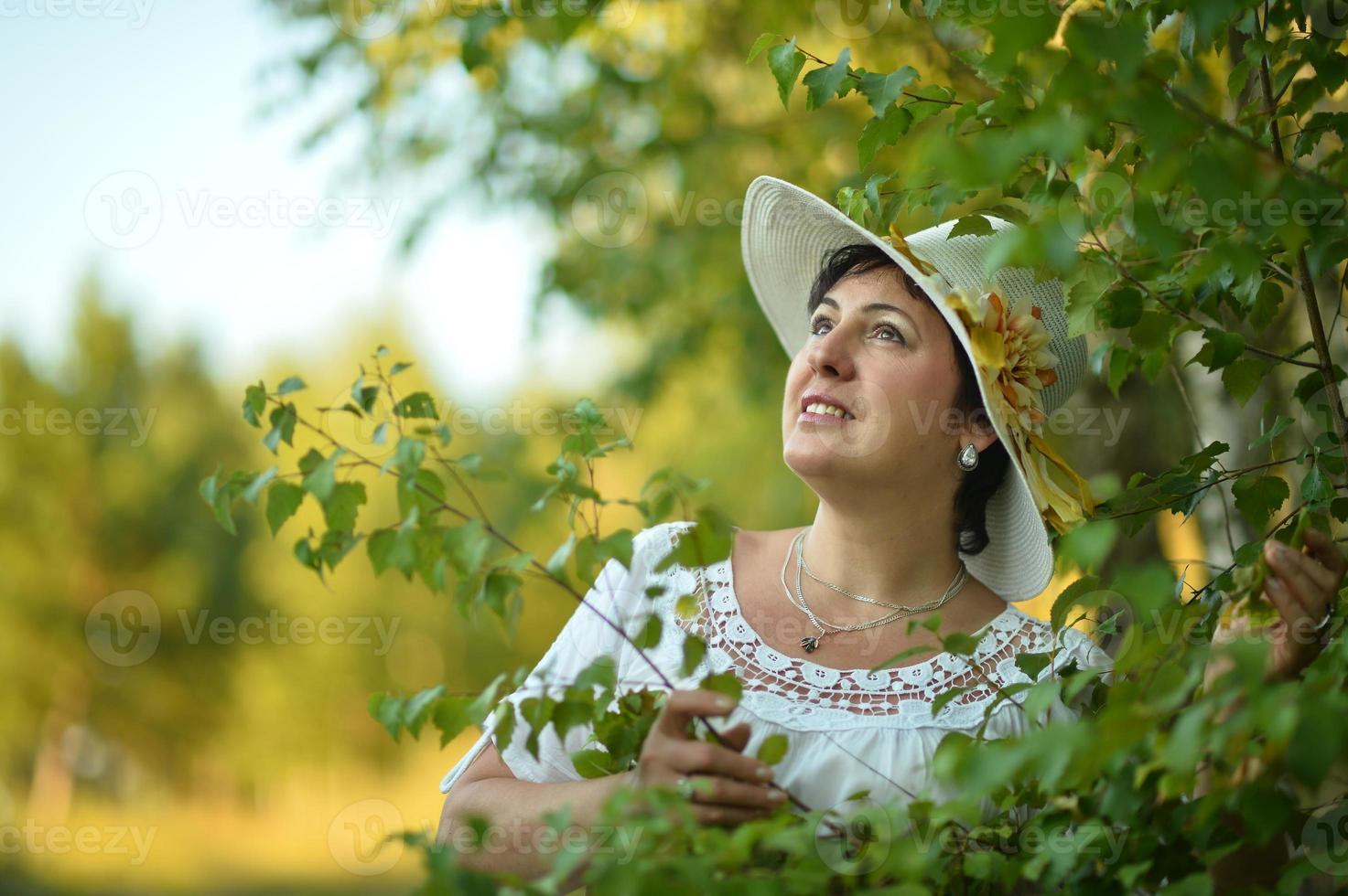 Lady enjoying summer outdoors photo