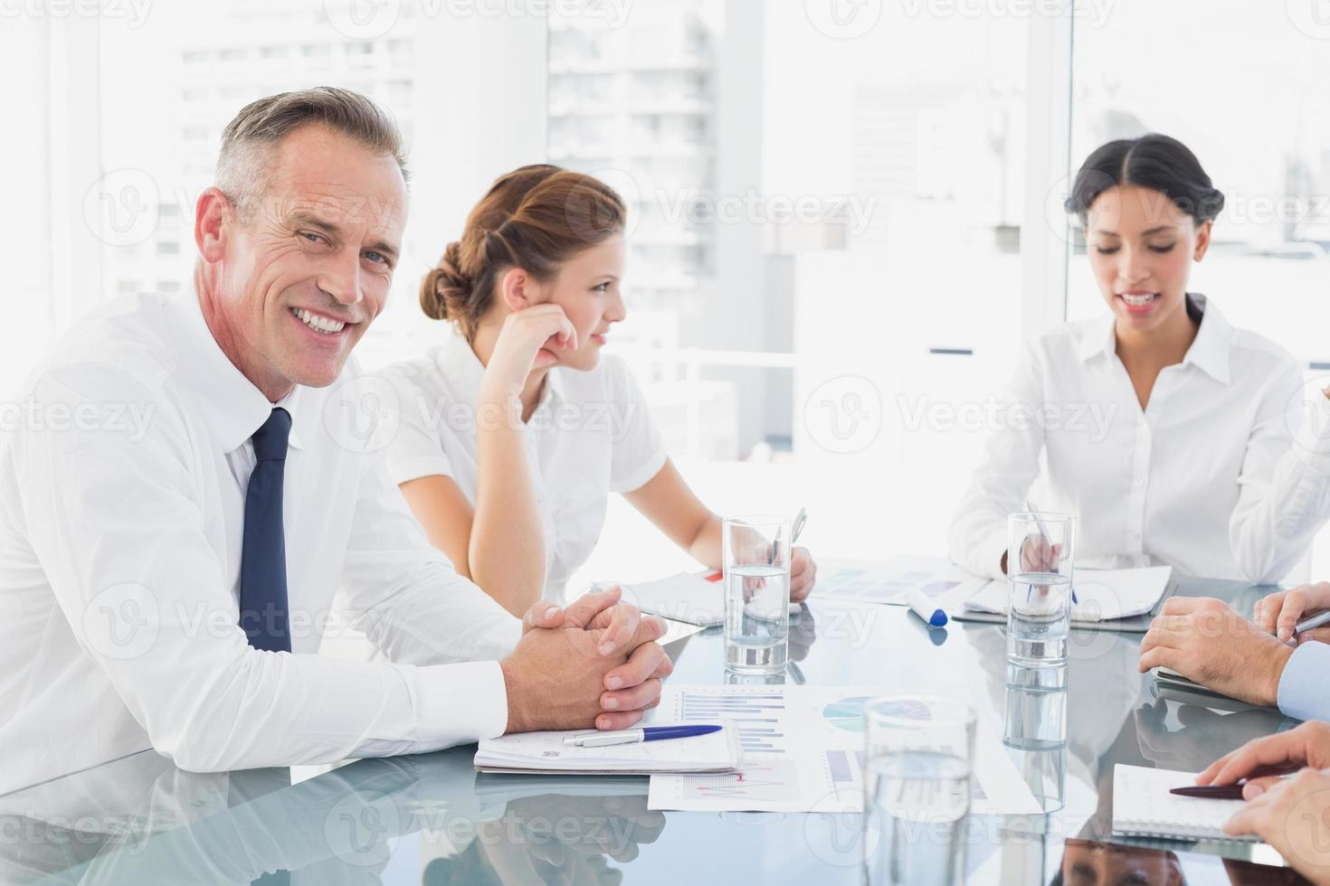 Businessman smiling in a meeting photo