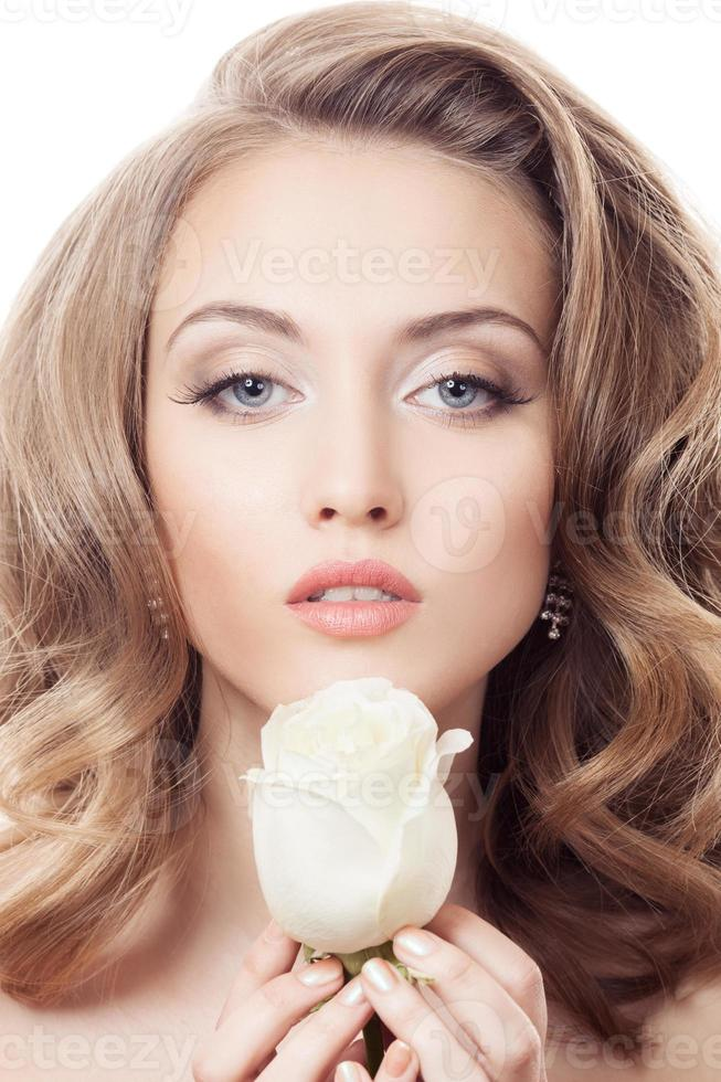 Beautiful Girl And Rose. Healthy Long Curly Hair. photo