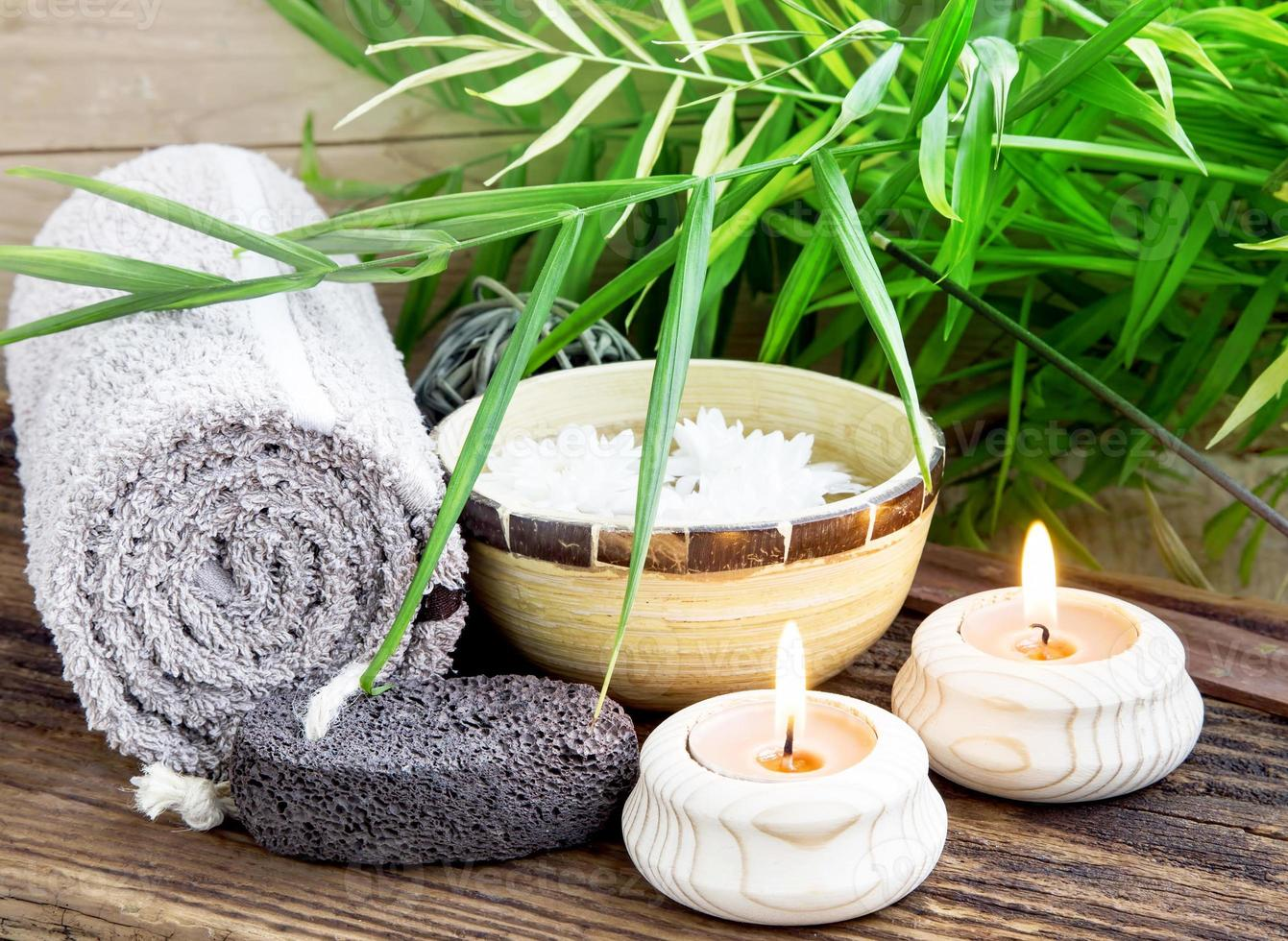 Spa Setting wiht Green Leaves and Burning Candles photo