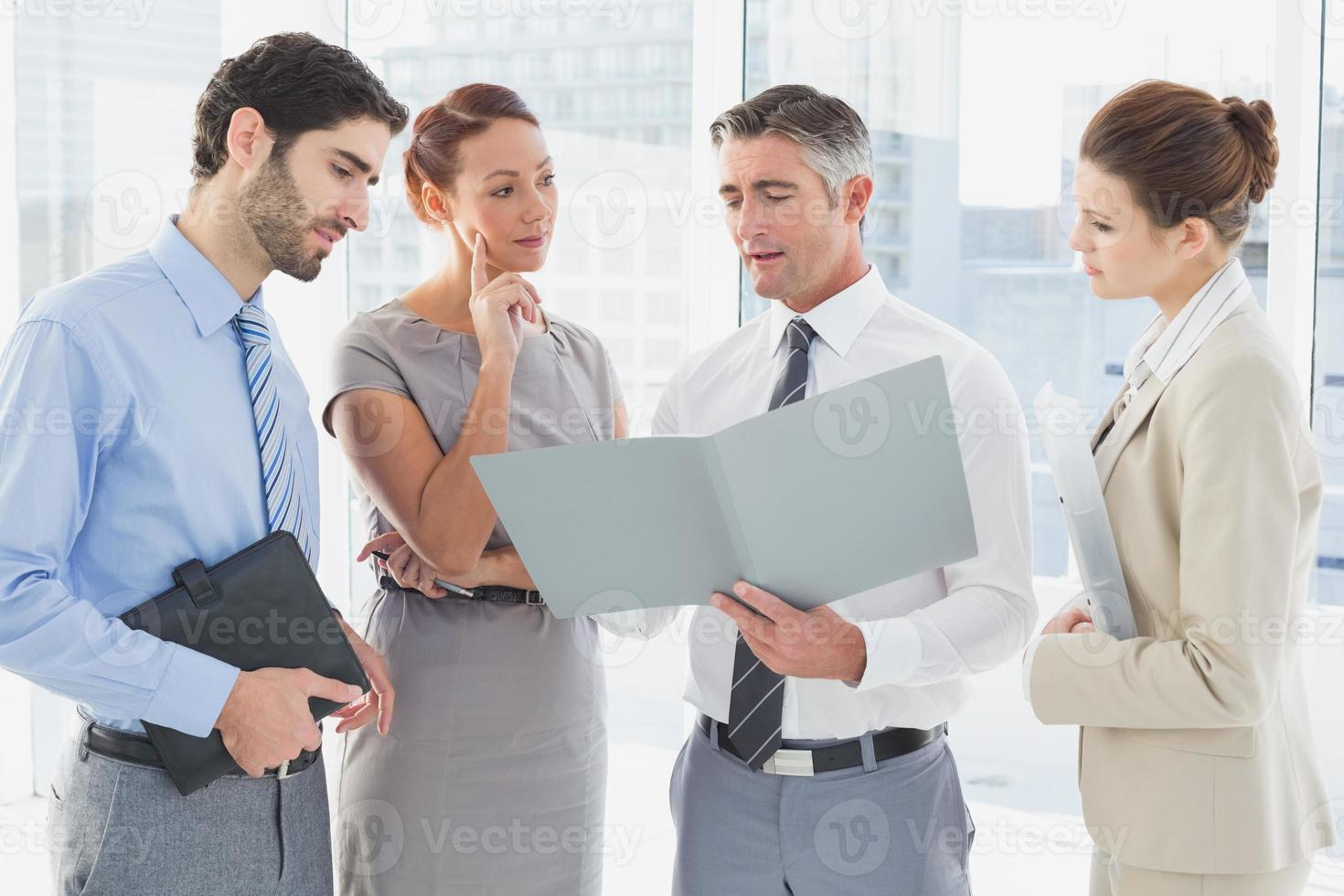 Employees having a business meeting photo