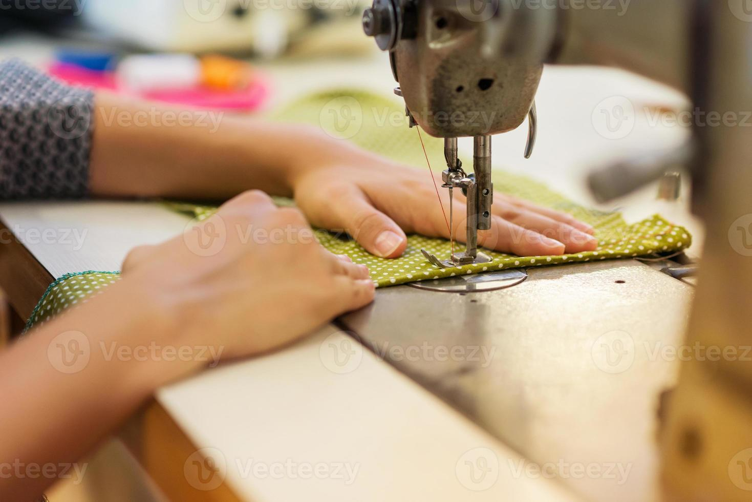 Young woman with sewing machine photo