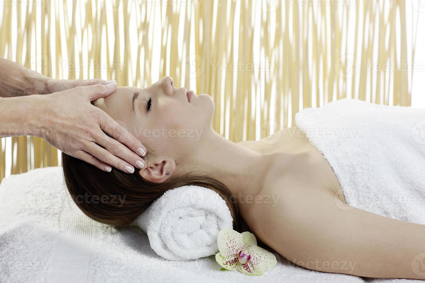 Young beautiful woman getting spa treatment photo